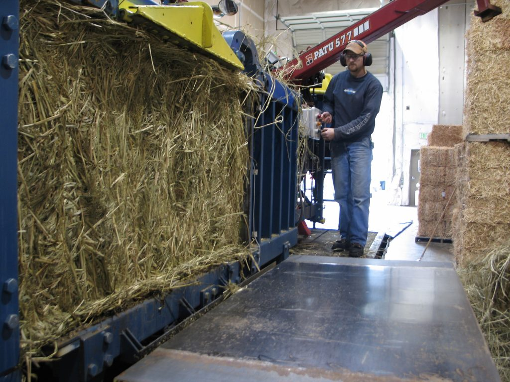 Ejecting biomass from baler