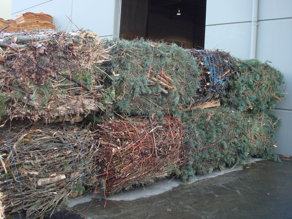 Large square bales of woody biomass